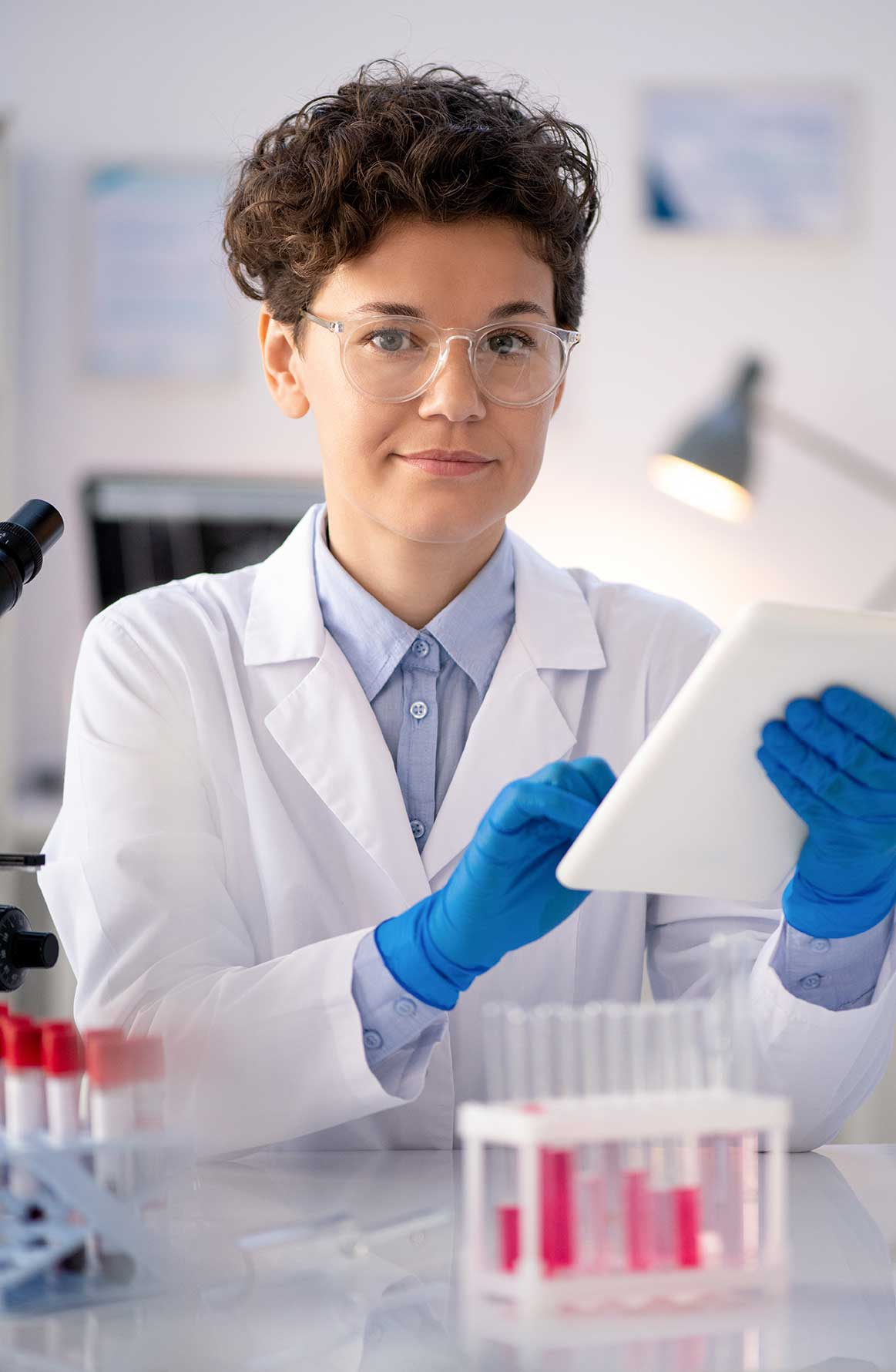 XPhyto strategic partnerships woman working in lab cropped alt